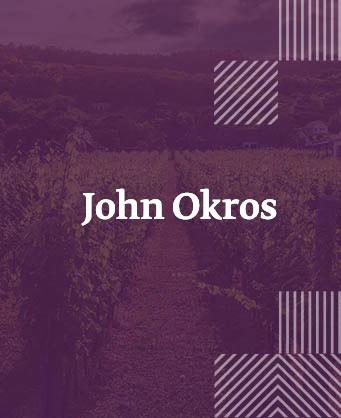Джон Окрос